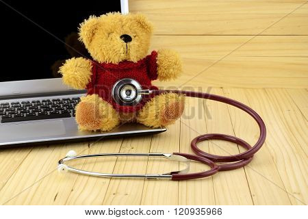 Toy Bear And Stethoscope In Children Clinic Concept.