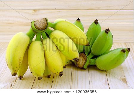 Cultivated Banana On Natural Wood Background.