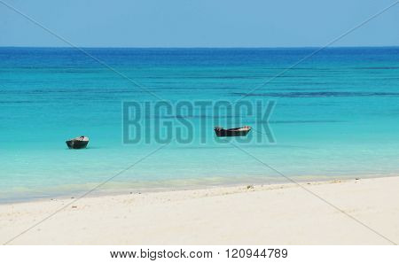 two vintage rowing boats on the water in the ocean