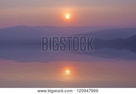 sunset with mountain with water reflection, view from Pha Keb Tawan, Nakhon Ratchasima, Thailand