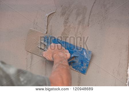 Hand Of Worker Use Trowel Plastering Concrete At Wall