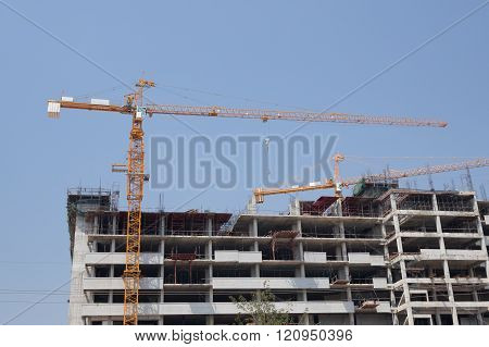 Crane under construction building with sky background