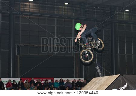 Stuntman Riding A Bike During Stunt Show