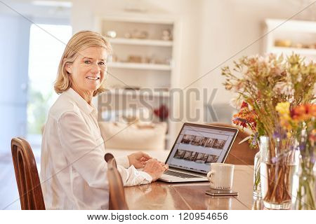 Portrait of a senior woman working on laptop at home