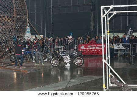 Stuntman preparing to ride in steel globe during stunt show