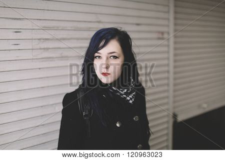 Portrait of young woman on the street