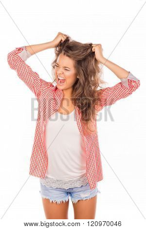 Angry Frustrated Young Woman Touching Her Head And Screaming