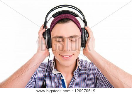 Happy Man In Violet Cap Listening Music With Closed Eyes