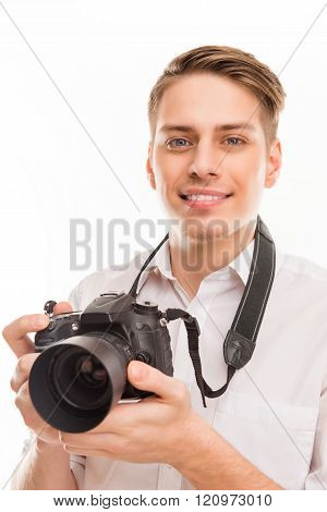 Close Up Photo Of Young Smiling Photographer Holding Camera