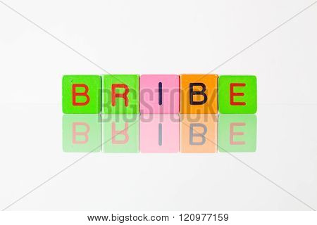 Bribe - An Inscription From Children's Blocks