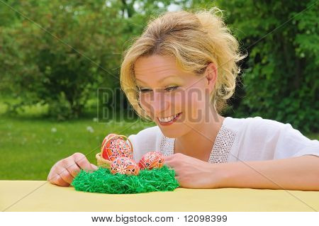 Young woman and easter eggs