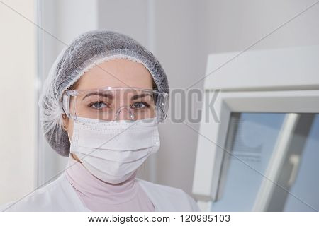 Woman In A White Protective Clothing