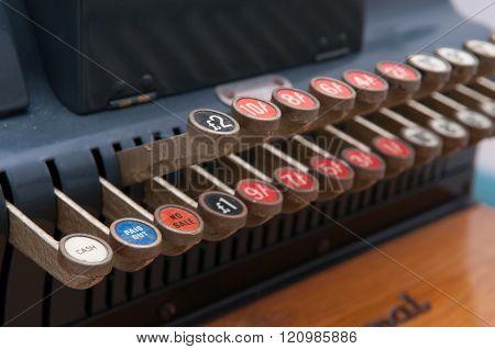 Close up of keys on a vintage cash register