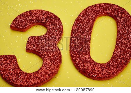 Number Thirty Red Color Over A Yellow Background. Anniversary.