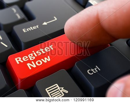 Finger Presses Red Keyboard Button Register Now.