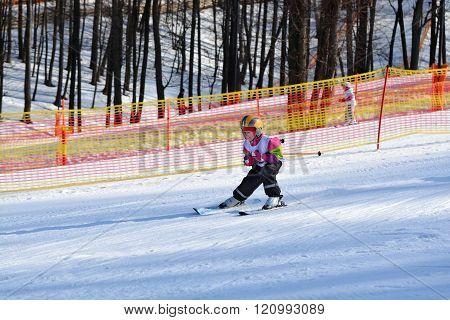 Skiing. Children's ski school. Girl on skis