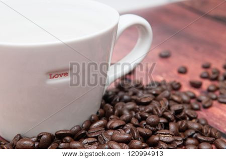 Strong flavoured coffee beans in a plain white mug ** Note: Shallow depth of field