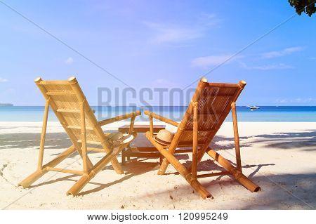chairs of tropical sand beach