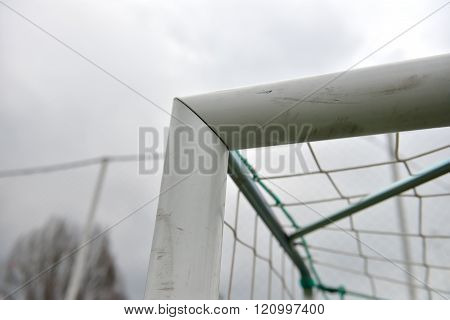 Detail Of A Used And Scratched Gate Of Football At A Soccer Field In Cloudy Day