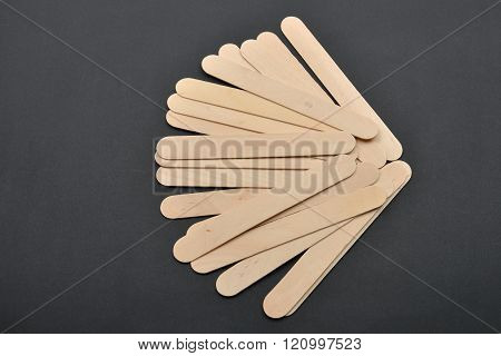 Picture Of Many Wooden Spatulas For Wax Depilation On Black Background