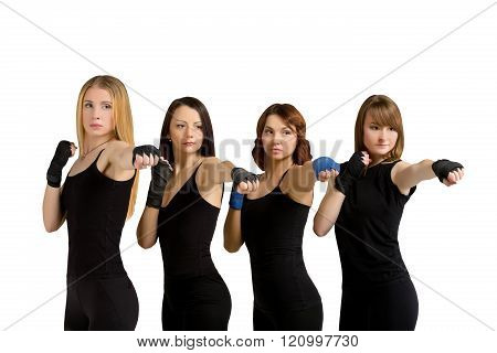 Group of women isolated at white making tae bo
