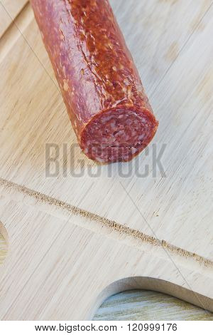 Long Loaf The Smoked Sausage On A Wooden Surface