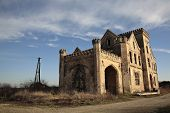 stock photo of raunchy  - old ravaged building for sale and renewal - JPG