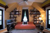 pic of futon  - symmetrical upstairs bedroom with futon and lcd tv - JPG