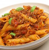 Penne pasta with a beef, pork and tomato ragu.