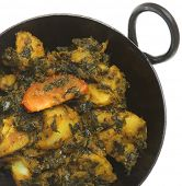 Indian vegetable curry with spinach and potato (sag aloo).