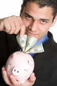 stock photo of spanish money  - Man Saving Money - JPG