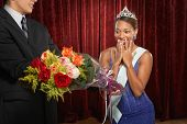 pic of beauty pageant  - Beauty queen gasping and receiving flowers - JPG