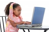 Beautiful Six Year Old Child Working On Laptop poster