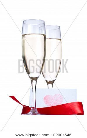 Glasses with Champagne and invitation card