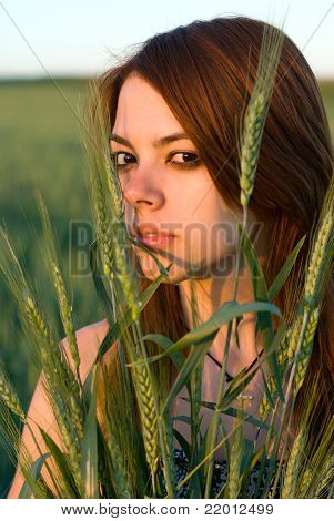 Young Woman And Cereal Crops
