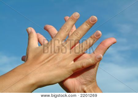 Hands In Hands Against Sky