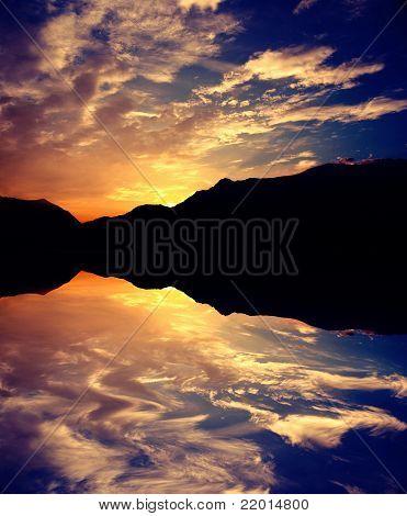 Amazing Sunrise Reflected On Water