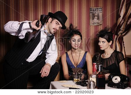 Gangsters playing cards, picture in retro style. Focus on  man.