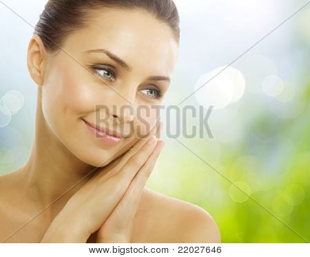 Beautiful Healthy Woman over Nature background.Perfect Healthy skin