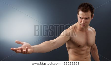 Light and power concept - creative muscular man holding bright sphere