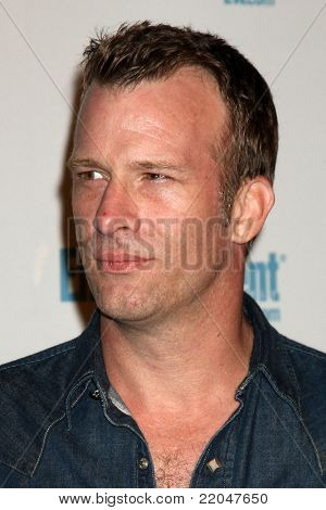 LOS ANGELES - JUL 23:  Thomas Jane arriving at the EW Comic-con Party 2011 at EW Comic-con Party 2011 on July 23, 2011 in Los Angeles, CA