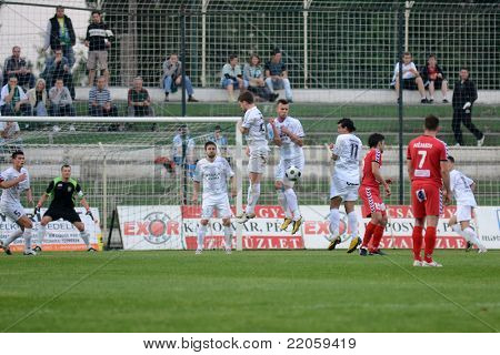 KAPOSVAR, HUNGARY - MAY 14: Unidentified players in action at a Hungarian National Championship soccer game - Kaposvar vs Szolnok on May 14, 2011 in Kaposvar, Hungary.