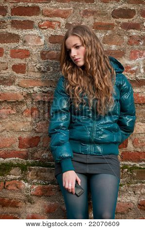 Unhappy Teen Girl With Mobile Phone
