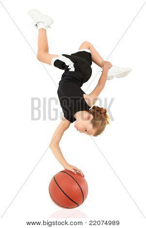 Young Girl Child Balancing Upsidedown On Basketball Over White
