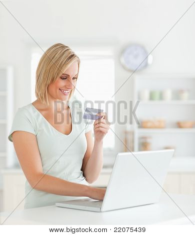 Blonde Woman With Credit Card And Notebook
