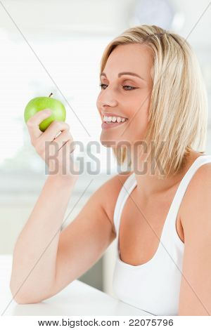 Young Smiling Woman Watching A Green Apple