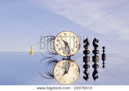 Clock And Chessmans On Mirror