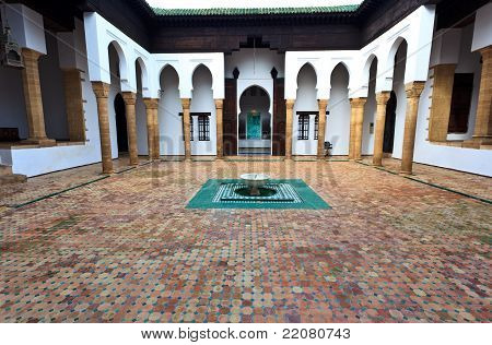 Interior Tiled Courtyard And Fountain Of Madrasa