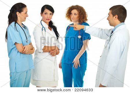 Accuser Doctor Pointing To His Team