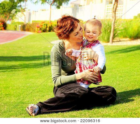 Mather & Baby Daughter Playing